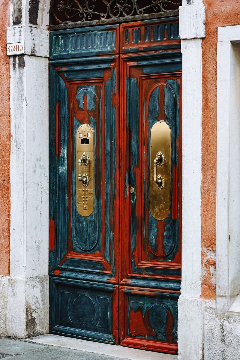 Brown wooden door with gold door knob