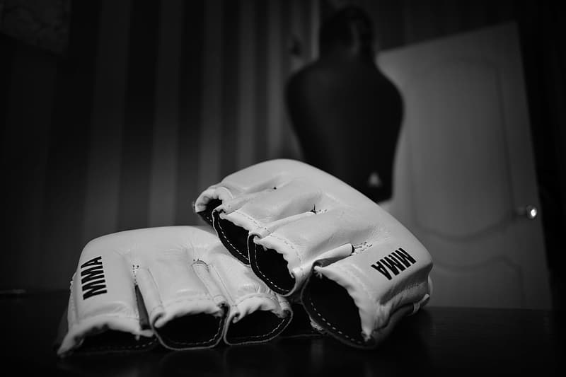 Pair of white MMA gloves on table