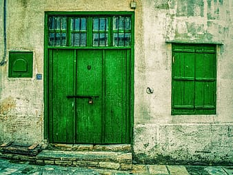 Green door during daytime