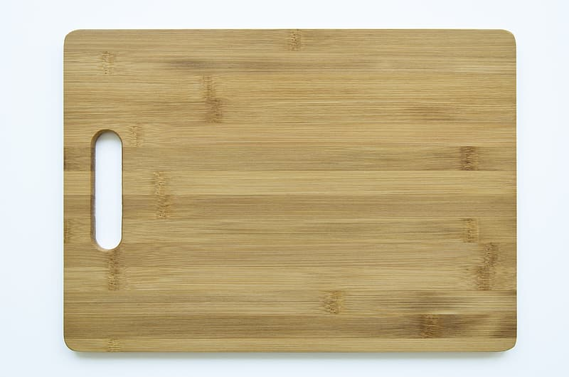 Brown wooden board with white plastic frame
