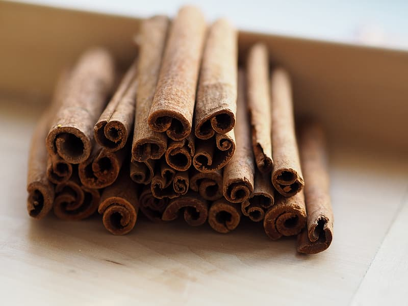 Brown wooden sticks on white wooden table