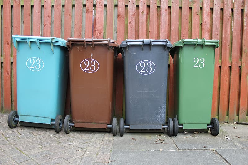 Four assorted-color garbage cans
