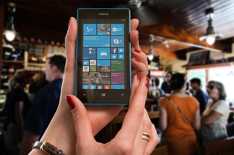 Person showing Nokia Windows phone home screen