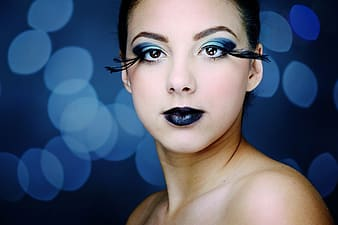 Woman with blue eyeshadow and black lipstick