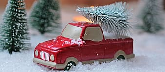 Red pick-up truck on snow