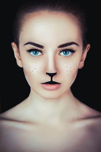 Woman with cat makeup photo