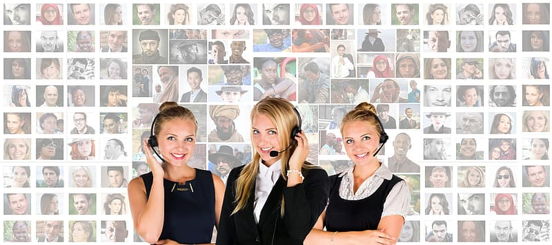 Three women wearing headset with woman portrait lot in background