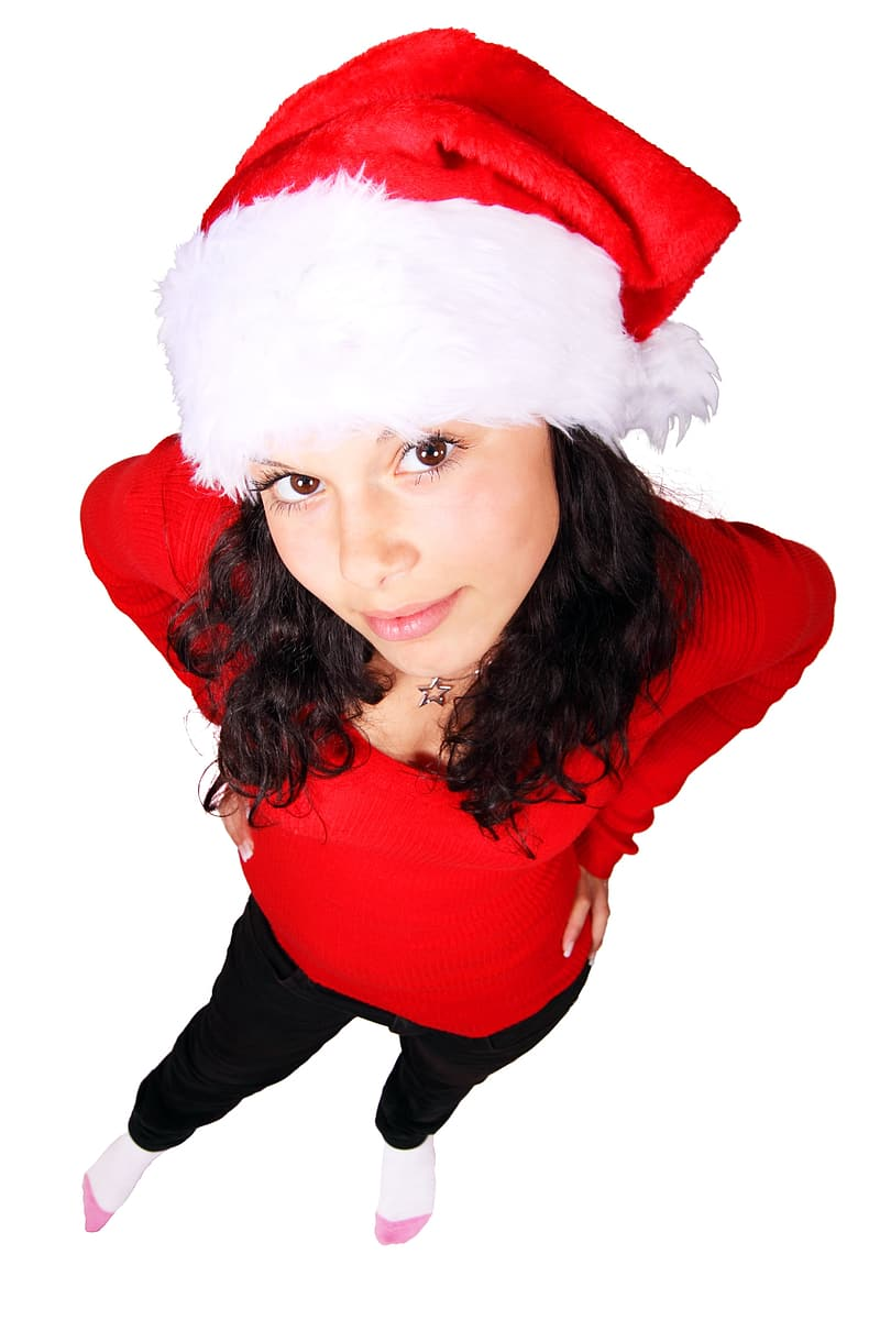 Black haired woman in red long-sleeved top and wearing santa hat