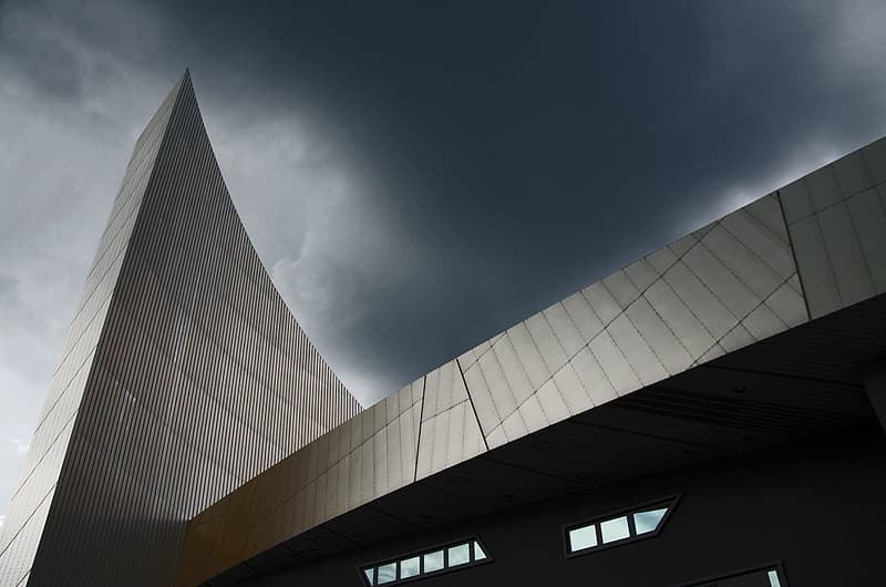 Low angle photography of gray glass building