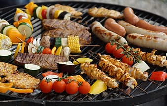 Assorted foods on grilling machine