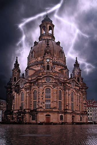 Brown cathedral with lightning