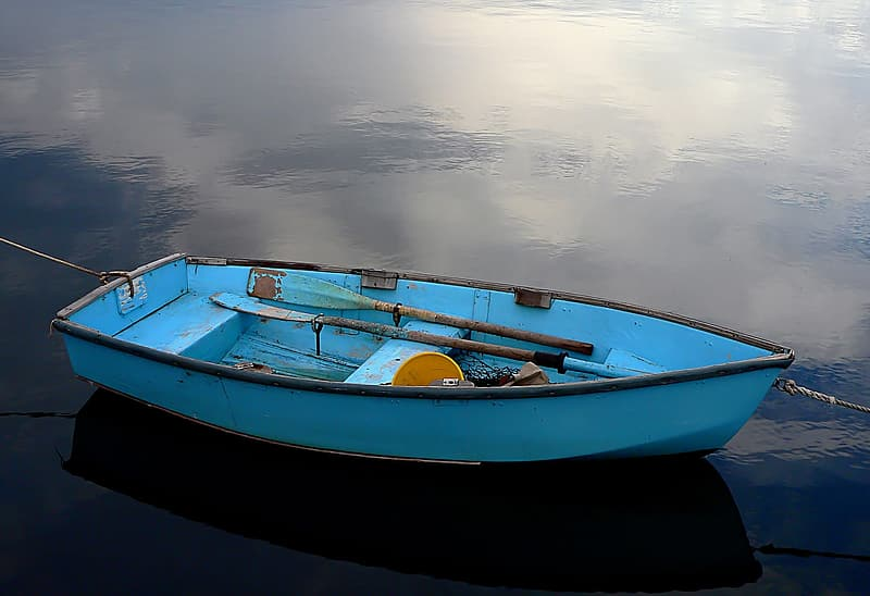Blue boat on waters