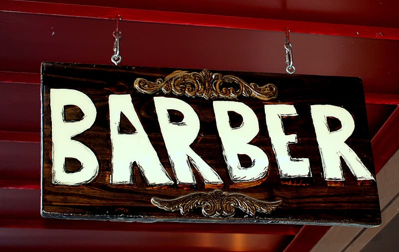 Brown and white Barber signage