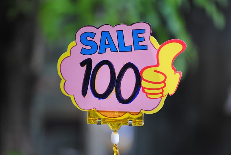 Selective focus photo of sale 100 signage