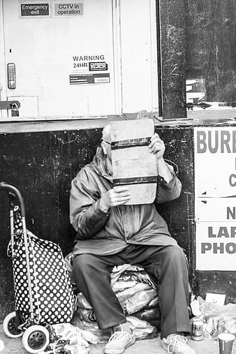 Grayscale photography of man holding paper