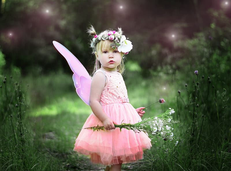 Girl wearing pink fairy costume