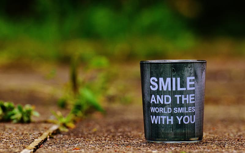 Brown and black smile and the world smiles with you-text bucket