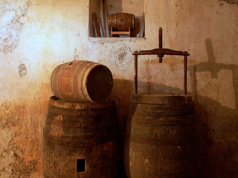 Two brown wooden barrels