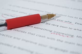 Close up photo of red pen