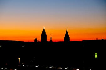 Silhouette of two towers during golden hour