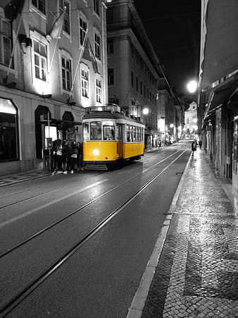 Selective color photograph yellow and white tram