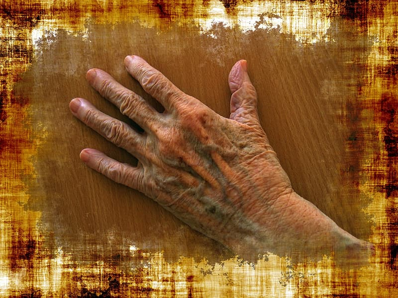 Left person's hand placed on brown surface