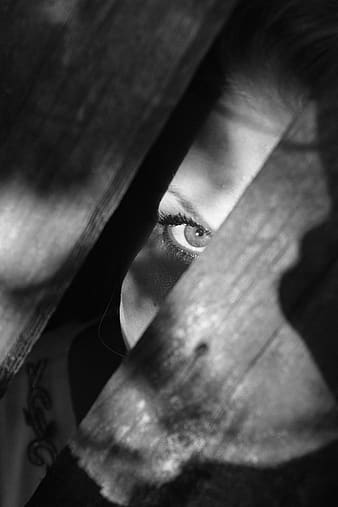 Photo of person peeking on wooden floor