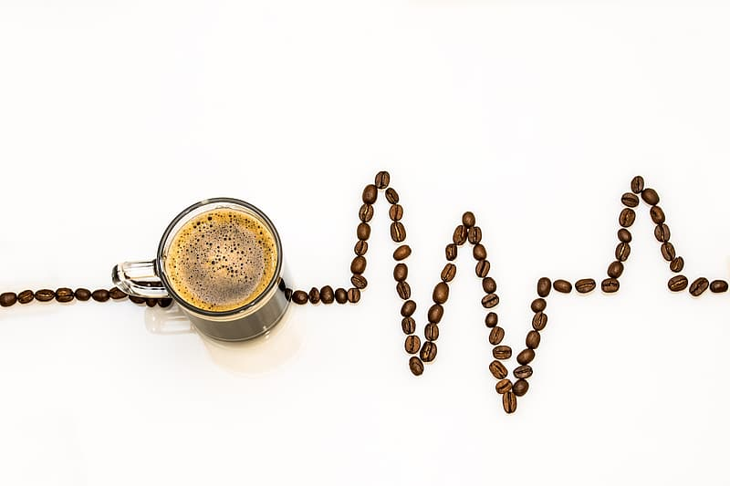 Coffee on glass mug with coffee beans showing life line
