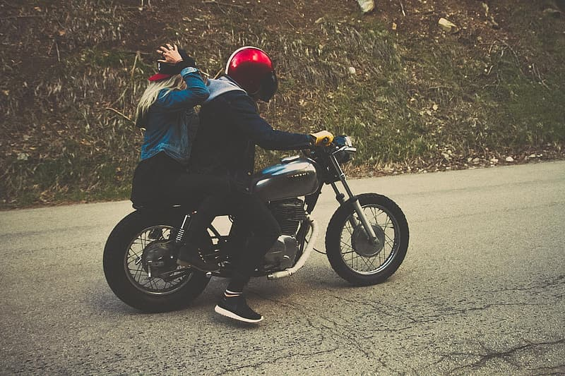 Photo of two woman and man riding motorcycle