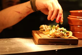Selective focus photography of soft taco on chopping board