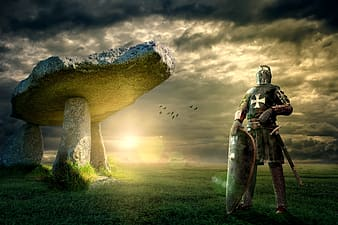 Knight wearing gray metal armor standing on green grass