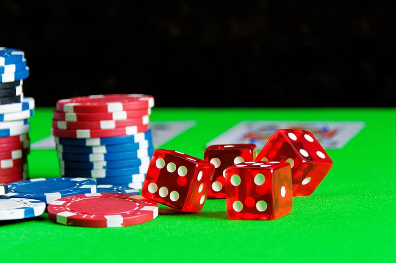 Poker chips and four dices