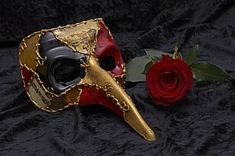 Multicolored festival mask with red rose