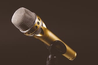 Gold microphone on black background