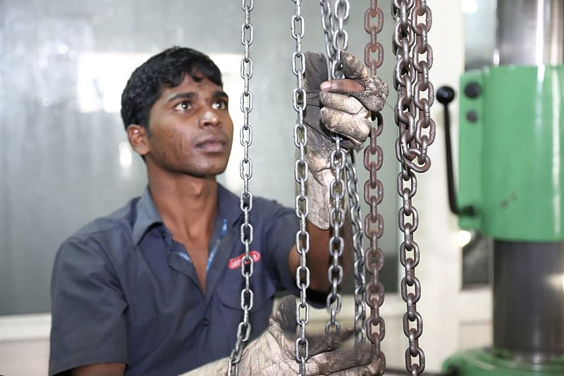 Man cleaning rusty chain