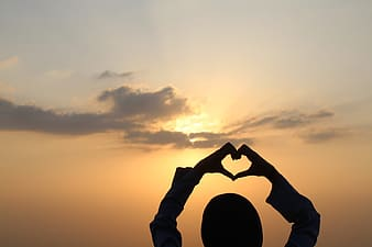 Silhouette of person heart gestures