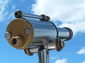 Telescope under cloudy sky during daytime