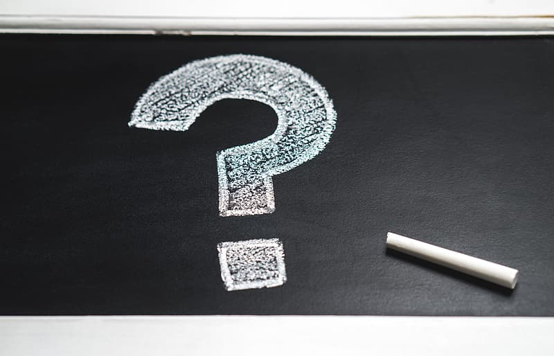 Question mark illustration on board with chalk