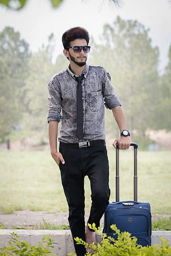 Man holding travel luggage