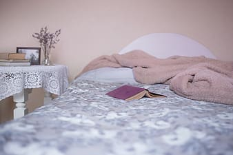 Blue covered book on bed