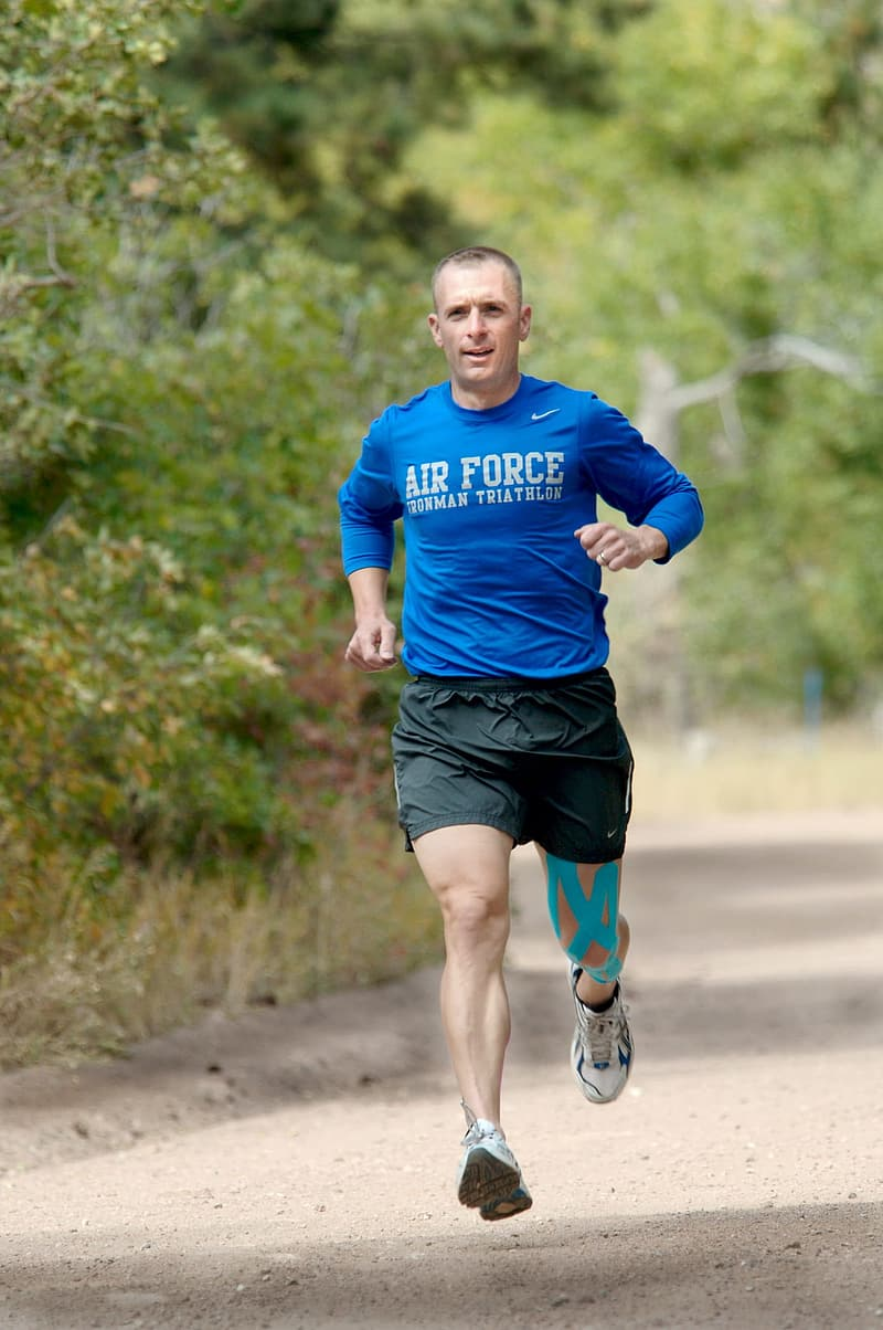 Man in blue long-sleeved shirt running