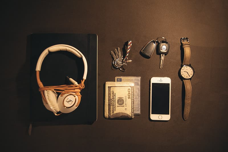 White and brown corded headphones near silver iPhone 5s