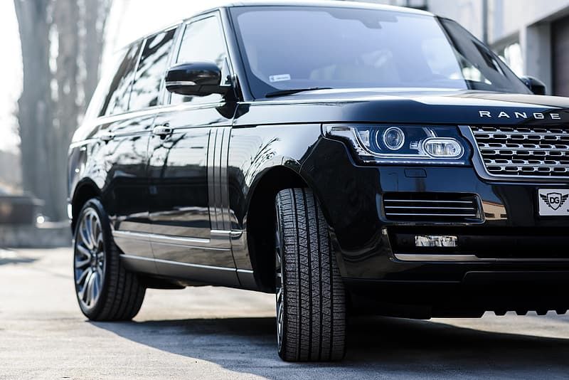 Black Land Rover Range Rover Sport HSE SUV parked near concrete building