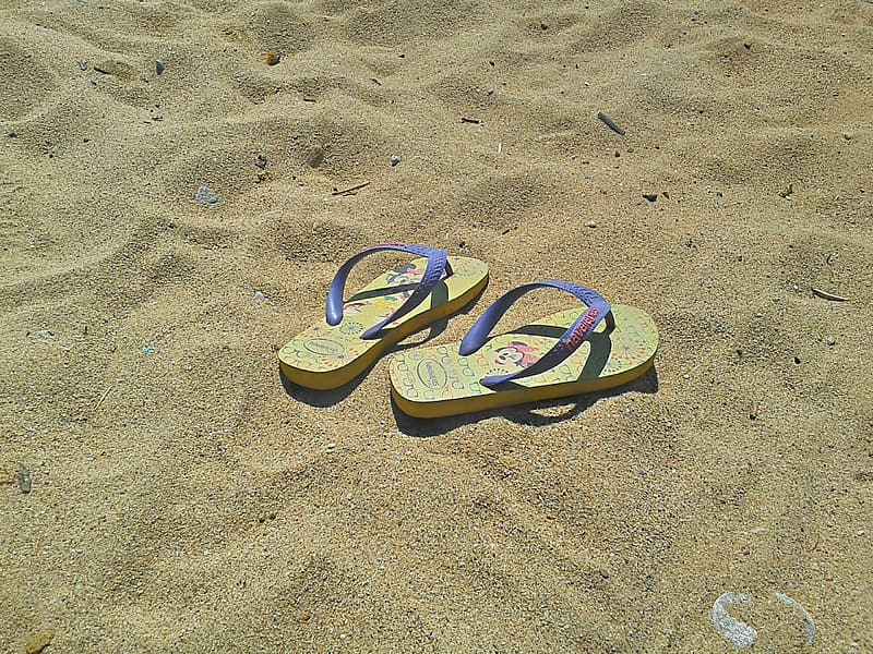 Pair of yellow-and-purple flip-flops