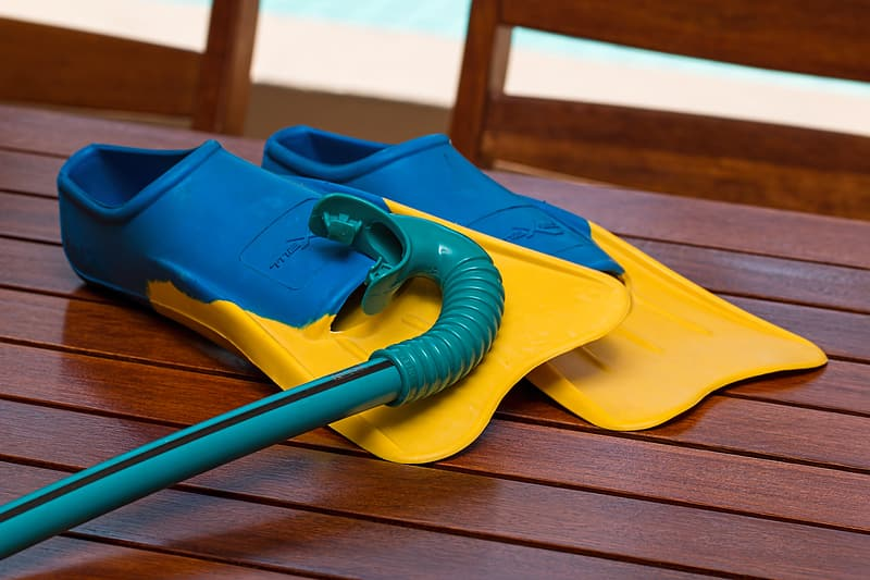 Blue-and-yellow flippers and snorkle