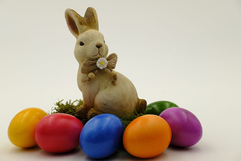 Brown rabbit with eggs figurine