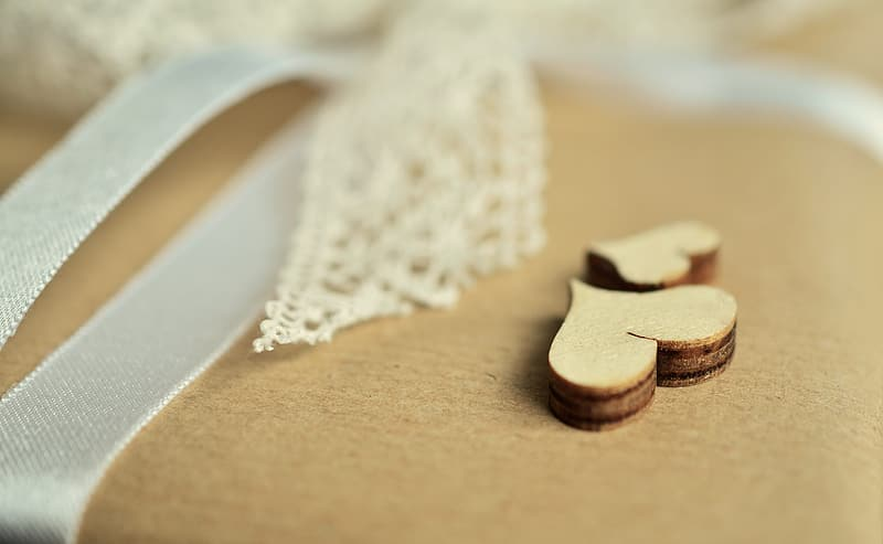Two brown wooden hearts decor
