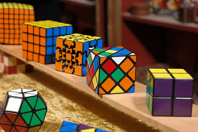 Rubik's cubes on brown surface