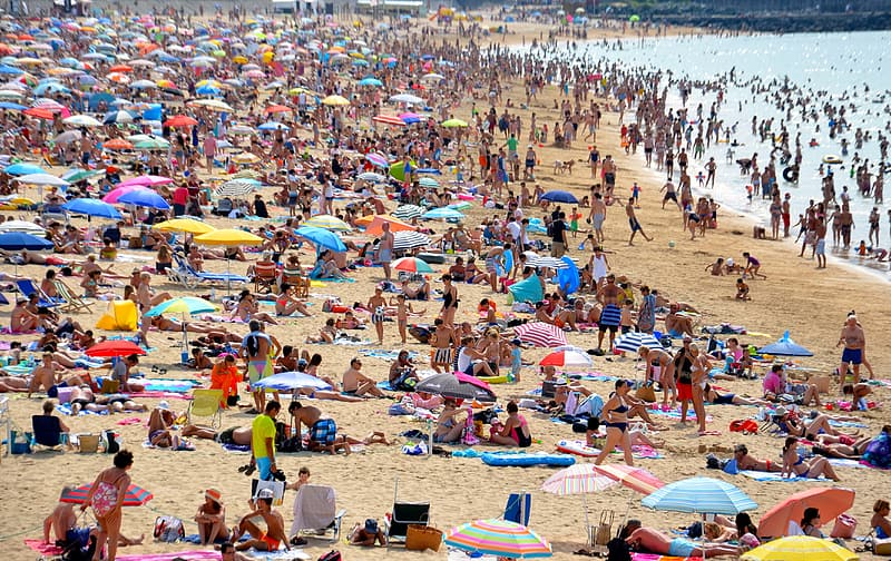 Crowd of people on beach during daytime