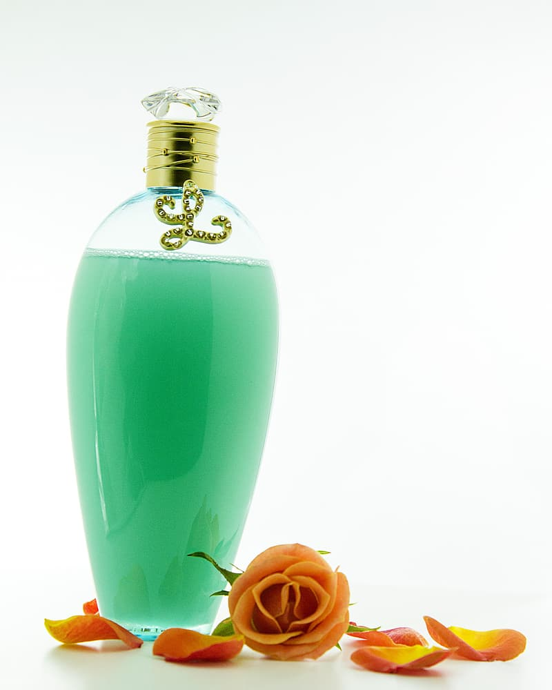 Clear glass bottle with green liquid